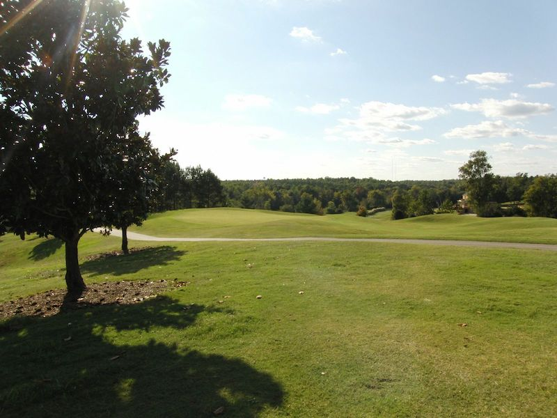 a picture of the golf course on a sunshiny day