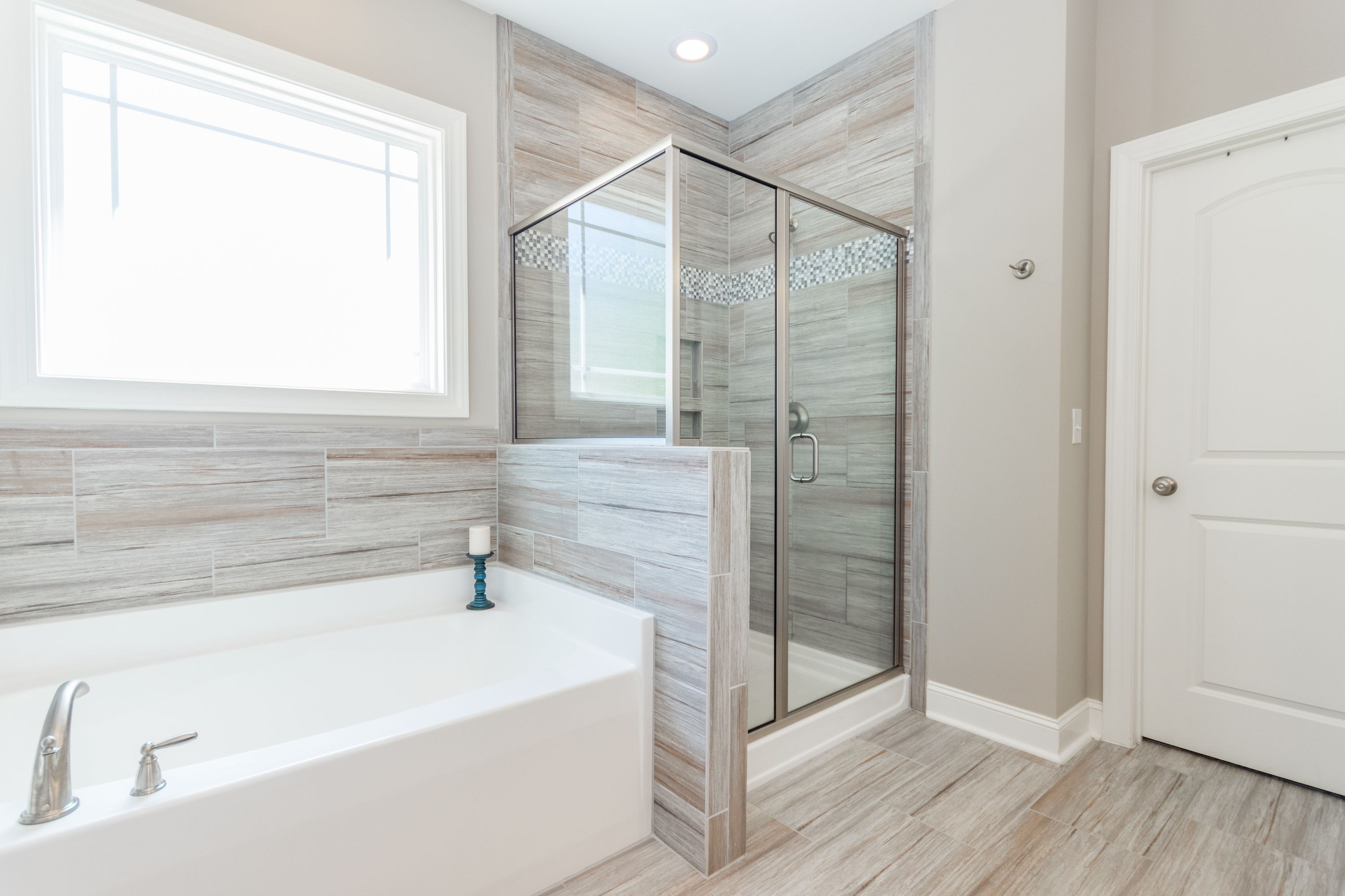Warm gray neutral master bathroom tile