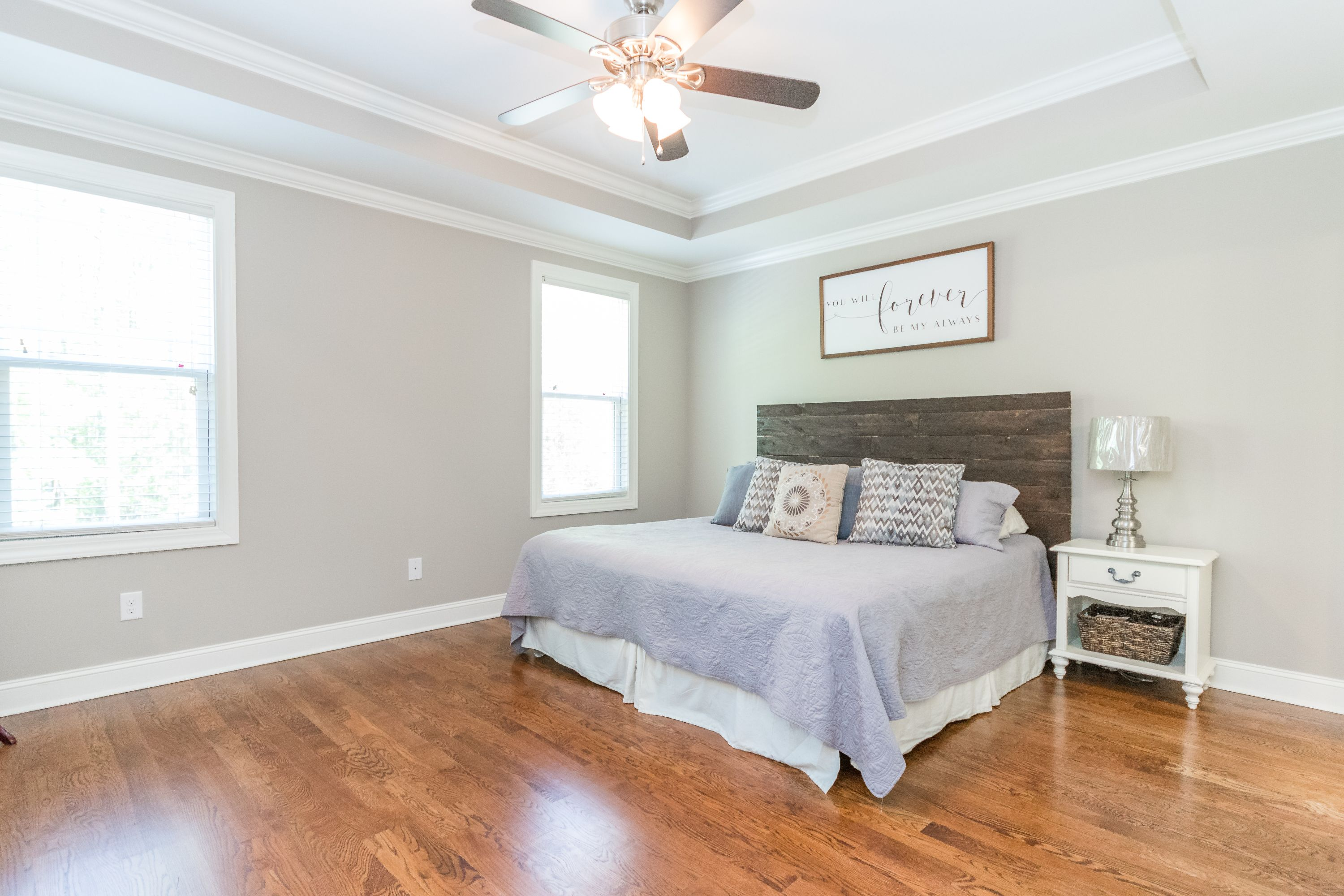 Hardwoods and trey ceiling in master bedroom